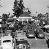 A view of Carl's Restaurant seen from its parking lot which is filled with cars