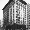 Corner view of Hollingsworth Building at Sixth Street and Hill Street, looking east toward Hill Street