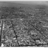 Aerial view of East Los Angeles showing Calvary Cemetery, Garfield High School, Long Beach Freeway (710), Civic Center, Atlantic Boulevard