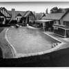 Exterior of residential home in Palm Springs with swimmimg pool in 1948, patio furniture