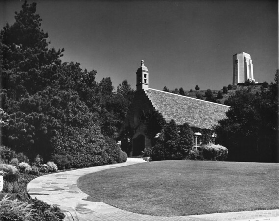 View of Stone chapel with ivy with a building in the far background at Forest Lawn Memorial Park