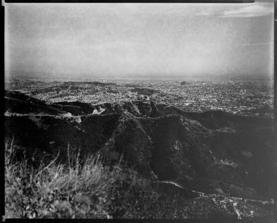 Aerial view of Los Angeles basin looking southeast from the San Gabriel Mountains, Chavez Ravine, City Hall is noticable in the distance