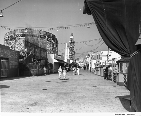 People strolling through the Ocean Park Pier amusement park