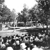 People watching an archery tournament at a Los Angeles city park