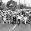 Men with buckets march in the American Legion Parade