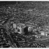Aerial view facing northwest over Wilshire Boulevard and San Vicente Avenue. McCarthy Vista, Crescent Heights Boulevard, May Company. Beverly Hills is to the west