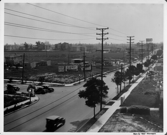 Looking down a commercial street with, Atlantic Richfield Gasoline, Quick Meal Advertisement, Wilshire Property at 636 South Western Avenue billboard, LA Bertha Apartments