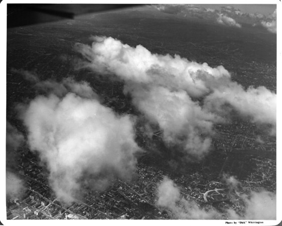 Aerial view of downtown Los Angeles over Bunker Hill looking north through the clouds towards Hollywood