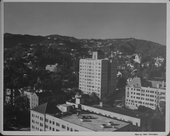 A high-angle view of the Hollywood Hills apartments as they are surrouded by the mountains