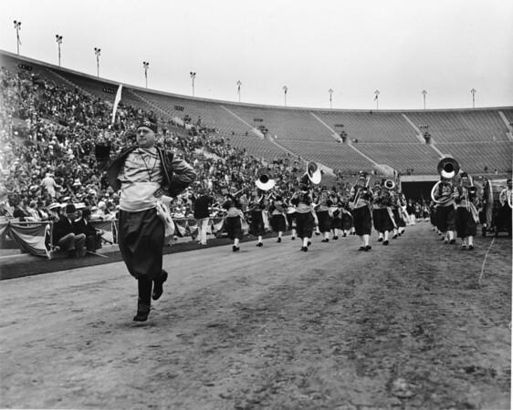Shrine parade at Coliseum featuring Shrine Band entering stadium