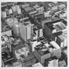 Aerial view of downtown Los Angeles, building rooftops, MTA Coach, New Rosselyn Hotels, Hotel Cecil, Financial Center Building, Security First National Bank