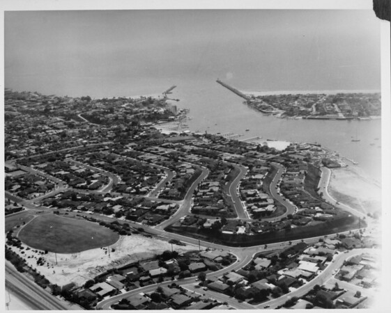 Aerial view overlooking the entrance to Newport Bay and the tip of the Balboa Peninsula in Newport Beach, California