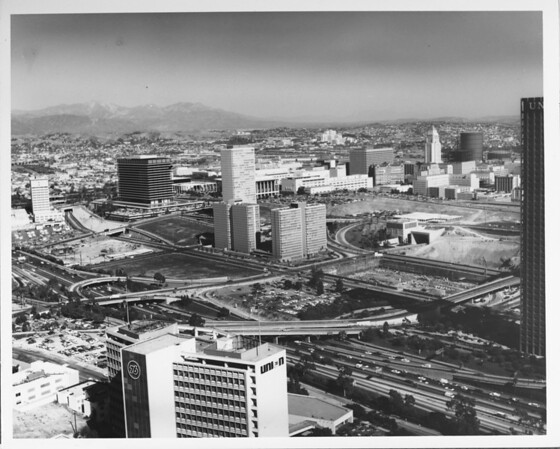 Aerial view of Downtown Los Angeles, Harbor Freeway (I-110), Los Angeles Music Center, Dorothy Chandler Pavillion, Civic Center, City Hall, San Gabriel Mountains