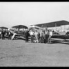 New airplanes and men at their airport on Angeles Mesa, Los Angeles, CA, 1929