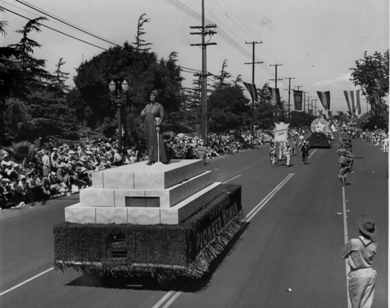 """American Legion parade, Long Beach, float celebrating the State of Oklahoma (statehood since 1907) featuring a """"pioneer woman"""""""