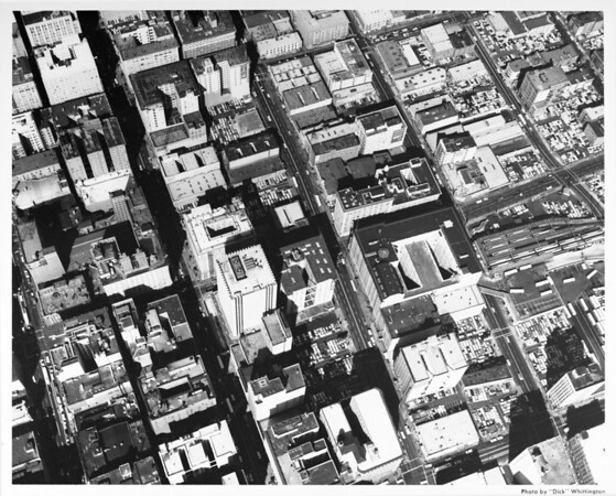 Aerial view of downtown Los Angeles looking north from Seventh Street, bus terminal, Sixth Street, Wall Street, Main Street, Spring Street, Maple Street, Fifth Street