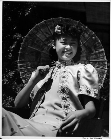 Girl on ricsha with parasol, Chinatown in 1948