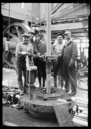 Go-around tongs in use in Torrance field, Torrance, CA, 1926