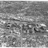 Aerial view of Exposition Park, Coliseum, University of Southern California (USC) campus, Figueroa Street, Jefferson Street, Martin Luther King Jr. Boulevard