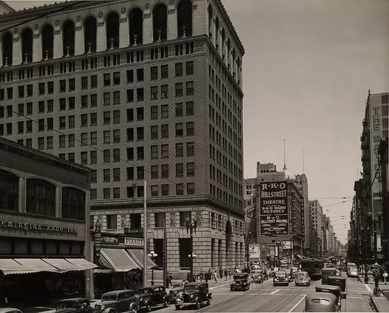 In Downtown Los Angeles facing north on South Hill Street at West Ninth Street towards the R.K.O. Theater (in the Hill Street Building)