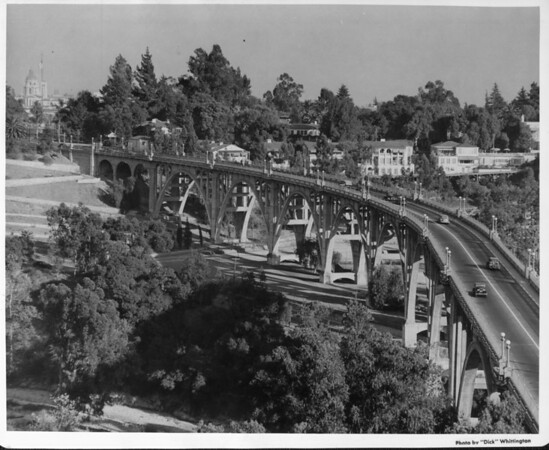 An aerial view of the Colorado Street Bridge with the Pasadena City Hall to the left