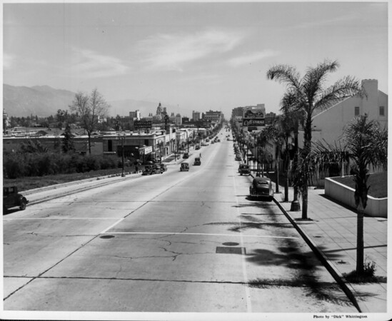 Looking down Colorado Street in Pasadena with the many buildings in a distance