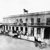People gathered outside of the Old Lanfranco block, Bath house, Workman Brothers, Harness Company