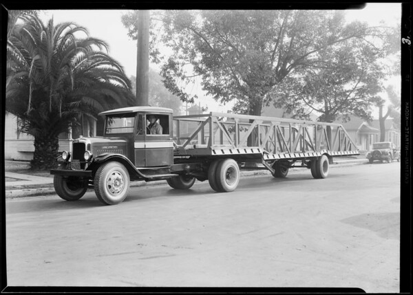 Fords on big trailer, Southern California, 1930