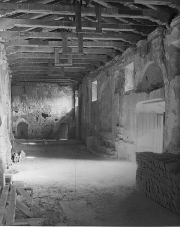 The deteriorating interior of a San Fernando Mission Building, showing adobe bricks which will be used in its renovation