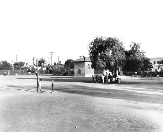 A few people gather at one of Los Angeles' many playgrounds