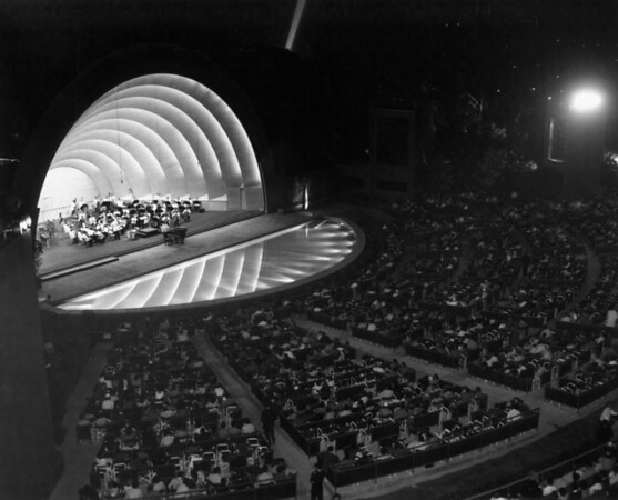 A small orchestra giving a nightime concert at the Hollywood Bowl