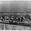 View from the rooftops of a community overlooking downtown Los Angeles (including City Hall) in the distance