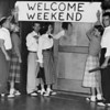 """University of Southern California (USC), Delta Sigmas and Pi Phis: students holding """"Welcome weekend"""" banner"""
