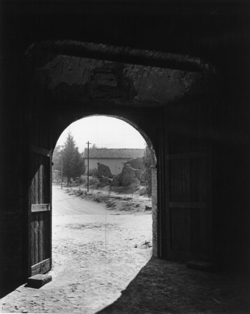 Looking out through a door at the San Fernando Mission