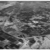 Aerial view of Indio, California, Route 111, Indio Boulevard, Indio High School, Indian Palms Country Club, County Center, fairgrounds, Date Festival