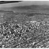 Aerial view of downtown Los Angeles looking north and west from the vicinity of San Pedro Avenue and Olympic Avenues