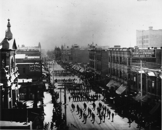 Looking south on Main Street from Second Street in Downtown Los Angeles as sailors march through town