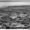 Aerial view of Indio, California, facing South Route 111, Indio Boulevard, Indio High School, Indian Palms Country Club, County Center, fairgrounds, Date Festival