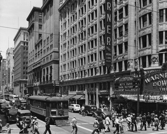 """Looking west along Seventh Street, with the Warner Brothers Downtown Theatre advertising """"Dark Victory"""" with Bette Davis, George Brent, and Humphrey Bogart"""