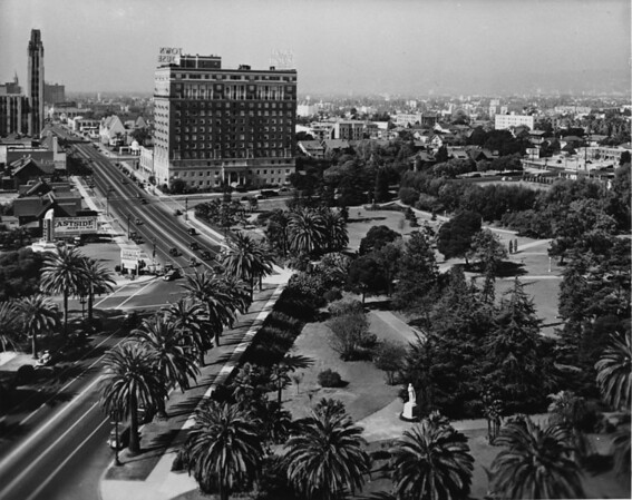Facing west on Wilshire Boulevard, Lafayette Park, I. Maginin Company, Simons, Town House