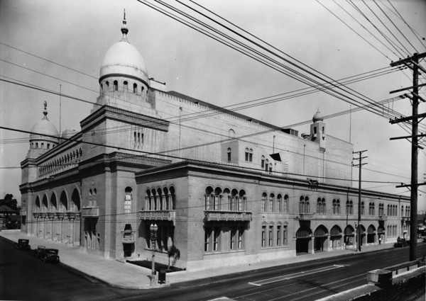 The Shriners Auditorium foregrounded by street electrical wires