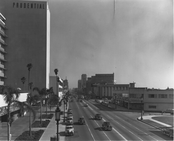 Looking eastward on Wilshire Boulevard at Sierra Bonita Drive, Prudential Building, Coulters, Young's Shoes, California Federal Savings, Ohrbachs