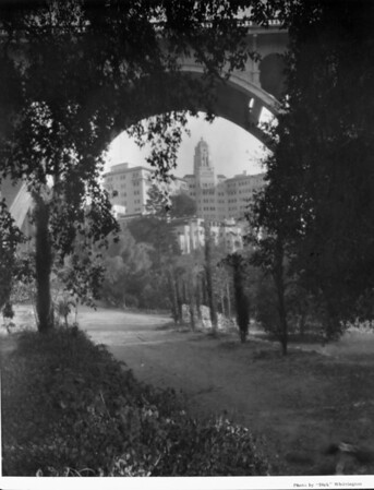 A view of the Vista Del Arroyo Hotel cropped by the underpass of a bridge which is surrounded by a beautiful landscape