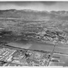 Aerial view of City of Industry facing north overlooking La Puente, San Jose Creek basin. Hacienda Boulevard, Valley Boulevard, Stimson Avenue, City of Industry City Hall, La Puente High School, Old Valley Road