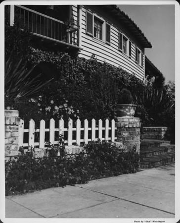 Residential home in 1948, picket fence, sidewalk, landscaping, flowers