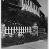 Residential home in 1948, picket fence, sidewalk, landscaping, flowers