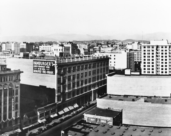 In Downtown Los Angeles, a view from above facing north on South Broadway at West Eighth Street showing Hamburger's Department Store