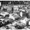 Aerial view facing north over the corner of Wilshire Boulevard and McCarty Drive in Beverly Hills