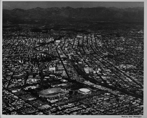 Late afternoon aerial photo facing northeast over Exposition Park looking into Downtown Los Angeles