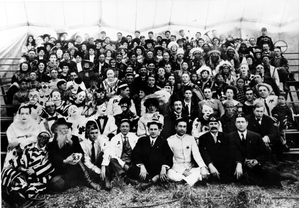 Shriner's parade, Los Angeles, showing a posed group photograph of participants in a tent